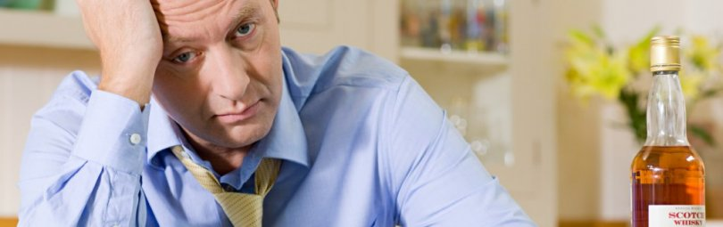 Stressed man with whisky --- Image by © Image Source/Corbis