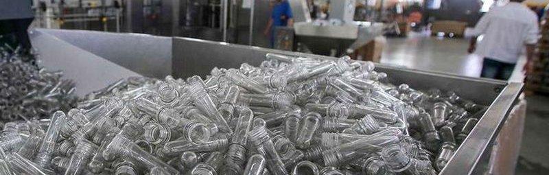 """GUDERMES, RUSSIA - JULY 22, 2016: Plastic bottles raw parts (PET preforms) in a workshop of Lider-A canning factory. Denis Abramov/TASS  Ðîññèÿ. Ãóäåðìåñ. 22 èþëÿ 2016. Çàãîòîâêè äëÿ ïëàñòèêîâûõ áóòûëîê (ïðåôîðìû ÏÝÒ) â öåõó ðîçëèâà âîäû è íàïèòêîâ êîíñåðâíîãî çàâîäà """"Ëèäåð-À"""". Äåíèñ Àáðàìîâ/ÒÀÑÑ"""